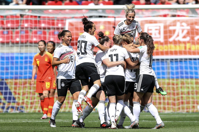 Giulia Gwinn celebrates with teammates after scoring her team's first goal in their group B match against China PR during the 2019 FIFA Women's World Cup at Roazhon Park in Rennes, France on Saturday