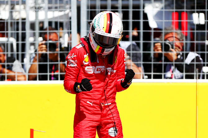 Pole position holder Sebastian Vettel of Germany and Ferrari celebrates in parc ferme after qualifying during the Canadian F1 Grand Prix at Circuit Gilles Villeneuve in Montreal, Canada, on Sunday