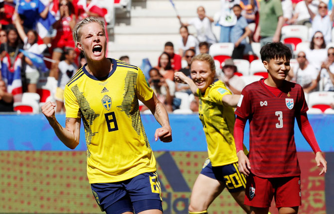 Sweden's Lina Hurtig celebrates scoring their fourth goal with Mimmi Larsson as Thailand's Natthakarn Chinwong reacts during their Women's World Cup Group F match at Stade de Nice, Nice, France on Sunday
