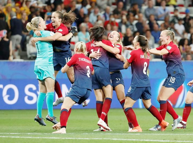 Norway's players celebrate after winning the match