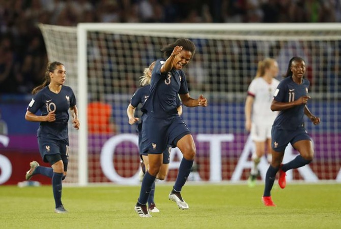 France defender Wendie Renard (3) celebrates after scoring