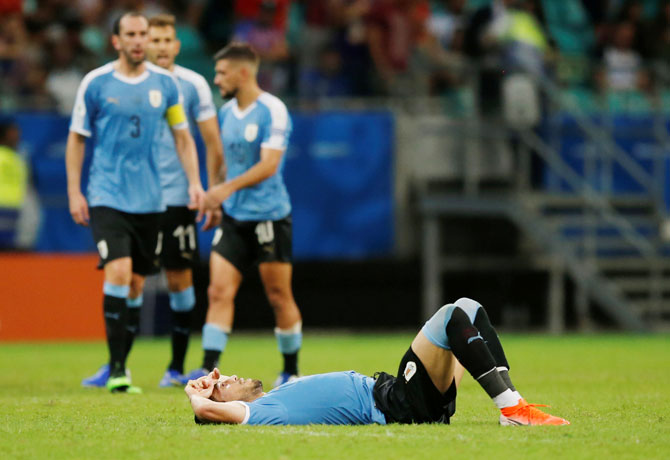 Uruguay players react at the end of their Copa America match against Peru