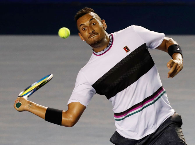 Australia's Nick Kyrgios plays a return during his semi-final match against USA's John Isner in  Acapulco in Mexico on Friday