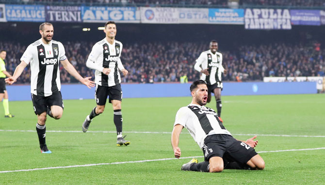 Juventus' Emre Can celebrates with teammates after scoring the team's second goal