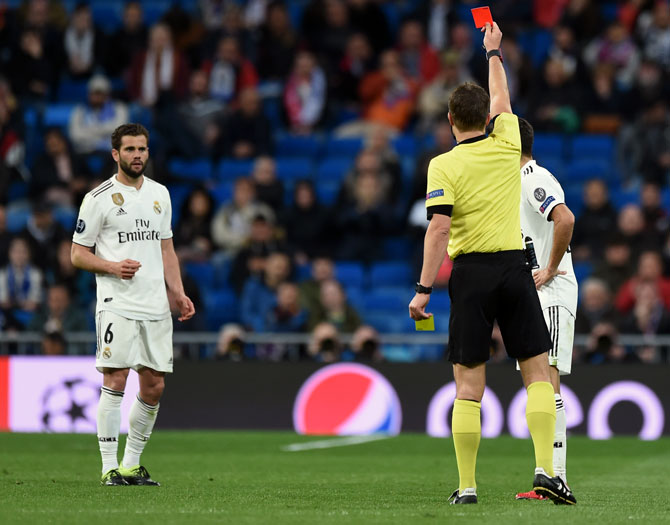 e167772a1d4 IMAGE  Referee Felix Brych shows the red card to Real Madrid s Nacho.  Photograph  Denis Doyle Getty Images