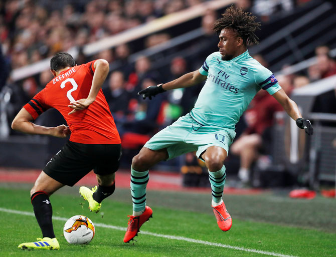 Arsenal's Alex Iwobi and Stade Rennes' Mehdi Zeffane vie for possession during their Europa League Round of 16 First Leg match at Stade Rennes in Roazhon Park, Rennes, France on Thursday, March 7