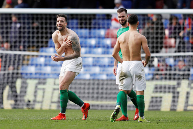 Brighton's Shane Duffy and Davy Propper celebrate after their win against Crystal Palace at Selhurst Park
