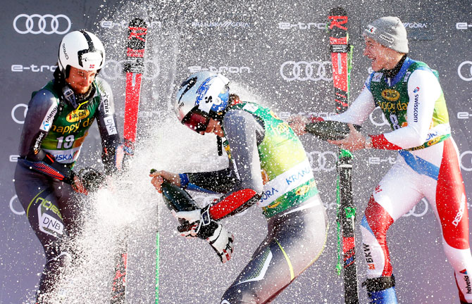 Norway's Henrik Kristoffersen celebrates winning the Men's Giant Slalom event with second placed Norway's Rasmus Windingstad and third placed Switzerland's Marco Odermatt at the Alpine Skiing World Cup on Saturday, March 9