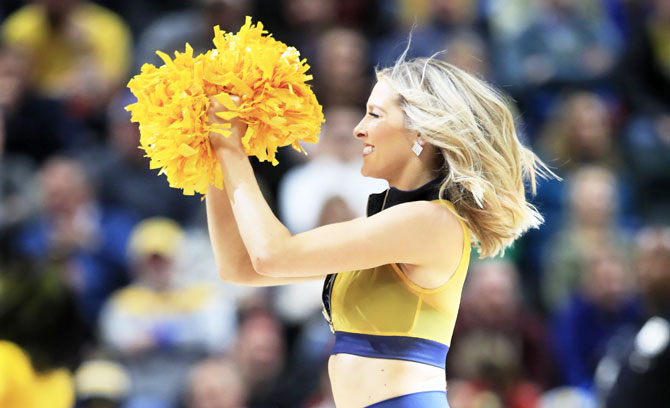 An Indiana Pacers' cheerleader performs during half-time of the game against the Chicago Bulls at Bankers Life Fieldhouse in Indianapolis, Indiana, on Tuesday, March 5