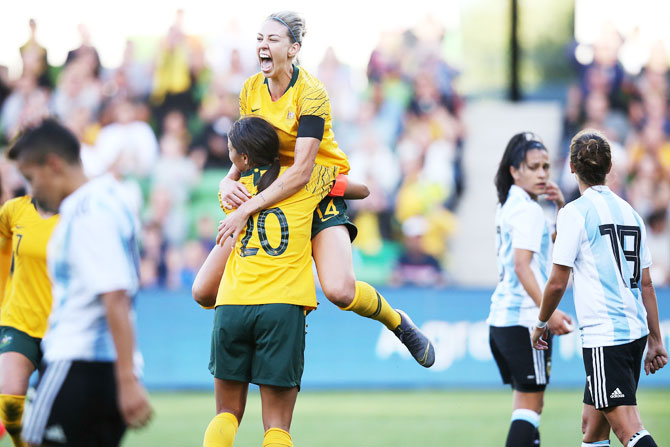 The Matildas' Alanna Kennedy celebrates a goal with teammate Sam Kerr during the Cup of Nations match between Australia and Argentina at AAMI Park in Melbourne, Australia, on Wednesday, March 06