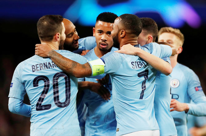 Manchester City's Gabriel Jesus celebrates scoring their seventh goal with teammates during their Champions League match on Tuesday