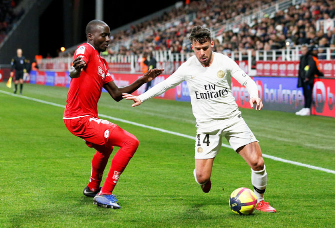 Paris St Germain's Juan Bernat in action with Dijon's Cedric Yambere during their Ligue 1 match at Stade Gaston Gerard, Dijon, France, on Tuesday