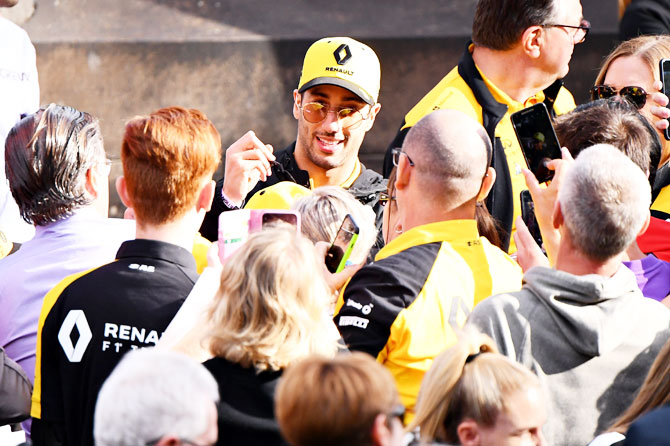 Renault's Australian driver Daniel Ricciardo signs interacts with fans at the F1 Live event on Wednesday