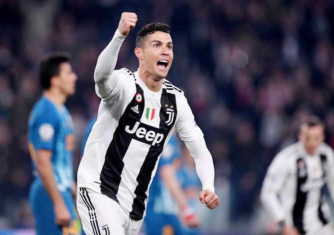 Juventus' Cristiano Ronaldo celebrates scoring their second goal against Atletico Madrid during their Champions League - Round of 16 Second Leg match at Allianz Stadium in Turin