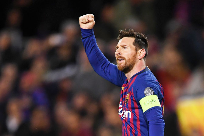 Barcelona's Lionel Messi celebrates scores his team's first goal from a penalty during their UEFA Champions League Round of 16 second leg match against Olympique Lyonnais at Nou Camp in Barcelona on Wednesday