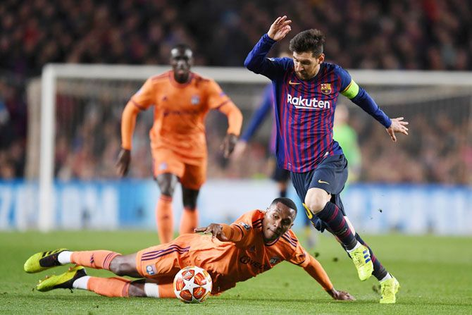 Lionel Messi evades Olympique Lyonnais' Marcelo as he presses forward during their UEFA Champions League Round of 16 second leg match against Olympique Lyonnais at Nou Camp in Barcelona on Wednesday