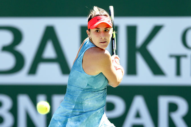Switzerland's Belinda Bencic returns a shot against Czech Republic's Karolina Pliskova in their semi-final at the Indian Wells Tennis Garden