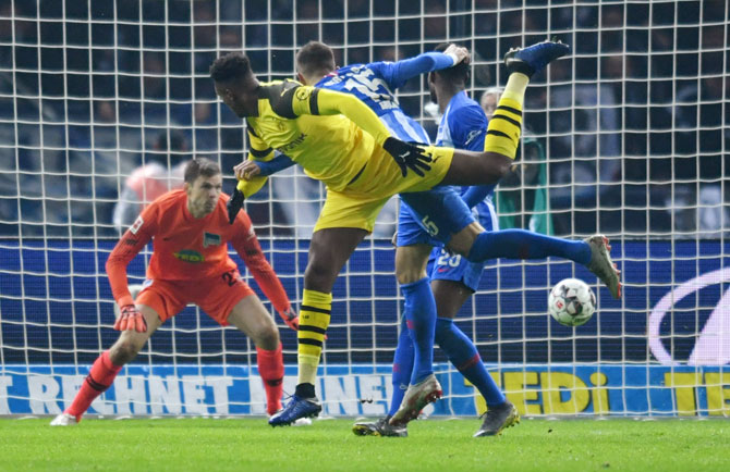 Borussia Dortmund's Dan-Axel Zagadou scores their second goal against Hertha Berlin in their Bundesliga match at Olympiastadion in Berlin on Saturday