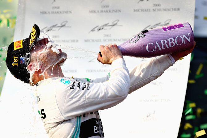 Mercedes GP'S Finnish driver Valtteri Bottas celebrates on the podium after winning the Australian F1 Grand Prix at Albert Park in Melbourne on Sunday