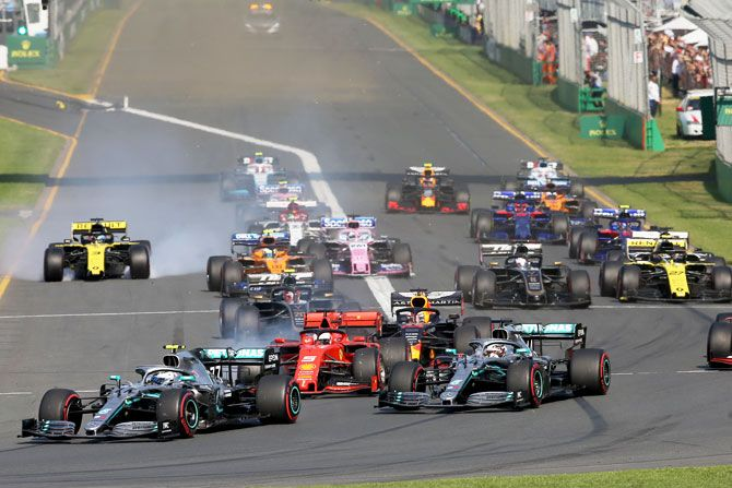 Valtteri Bottas driving the (77) Mercedes AMG Petronas F1 Team Mercedes W10 leads teammate Lewis Hamilton and the rest of the field at the start during the Australian F1 Grand Prix at Albert Park in Melbourne on Sunday
