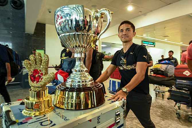 A file photo of Bengaluru FC Skipper Sunil Chhetri arrives at Bengaluru airport with the ISL trophy