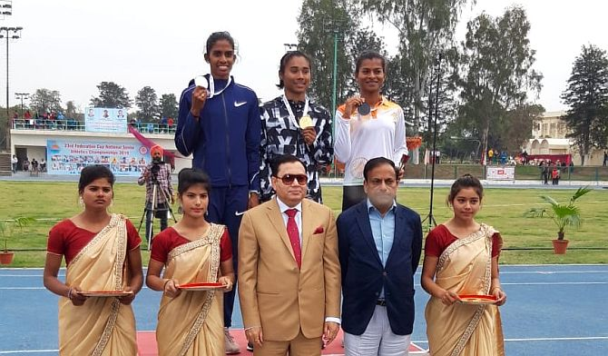 Hima Das (centre) won gold in the 400m event on Monday. Here she is on the podium with the silver and bronze medallists