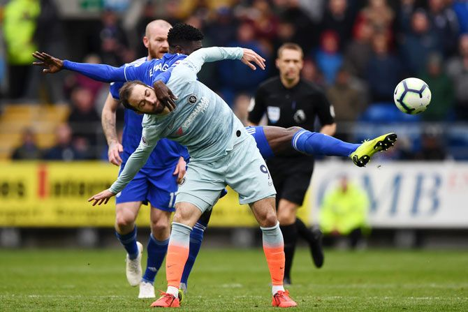 Chelsea's Gonzalo Higuain battles for possession with Cardiff City's Bruno Ecuele Manga during their EPL match in Cardiff on Sunday