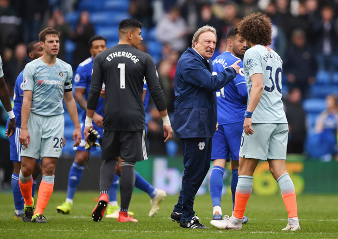 Cardiff manager Neil Warnock has words with Chelsea's David Luiz after the match