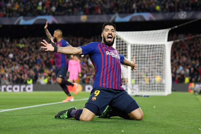 Barcelona's Luis Suarez  celebrates after he scores the first goal against Liverpool during the UEFA Champions League semi-final first leg match at the Nou Camp in Barcelona, Spain, on Wednesday
