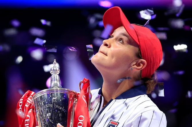 Australia's Ashleigh Barty poses with a trophy as she celebrates beating Ukraine's Elina Svitolina in the final WTA Finals in Shenzhen.