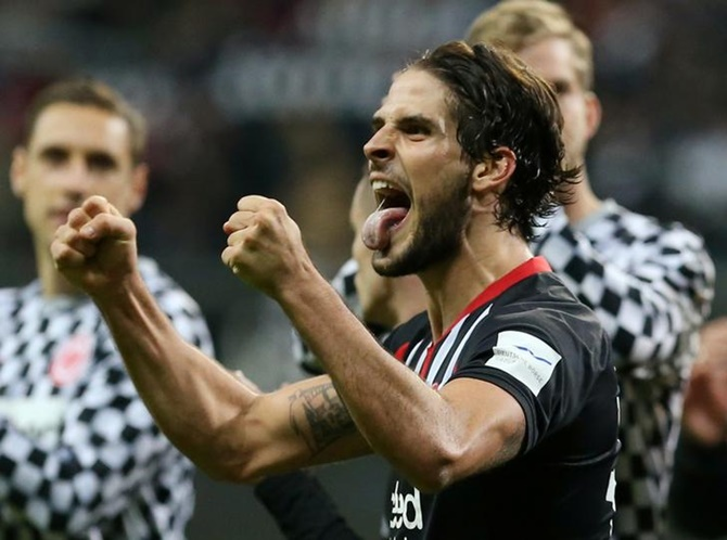 Goncalo Paciencia, who scored Frankfurt's fifth goal, celebrates at the end of the match.