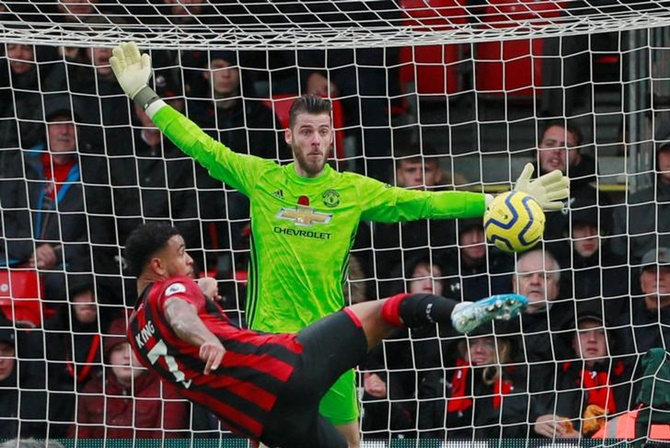 Bournemouth's Joshua King beats Manchester United goalkeeper David de Gea for the only goal of their match.
