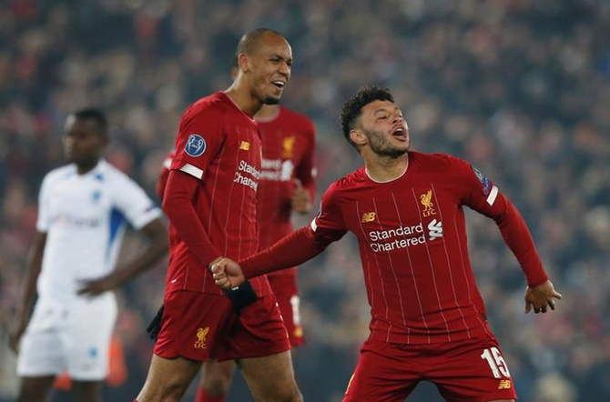 Alex Oxlade-Chamberlain celebrates scoring Liverpool's second goal in the Group E match against Genk