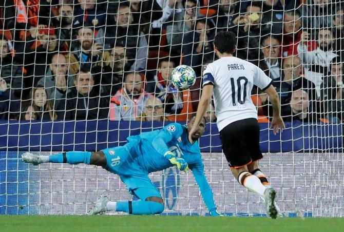 Dani Parejo scores Valencia's first goal from the penalty spot