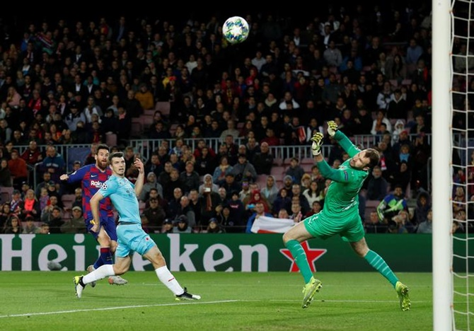 Slavia Prague's Ondrej Kolar saves a shot from Barcelona's Lionel Messi
