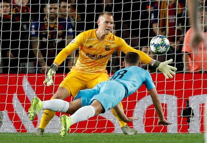 Barcelona goalkeeper Marc-Andre ter Stegen makes a save off Slavia Prague's Jan Boril.