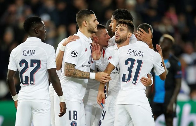 Mauro Icardi celebrates with his Paris St Germain's teammates after scoring  in the Group A match against Club Brugge