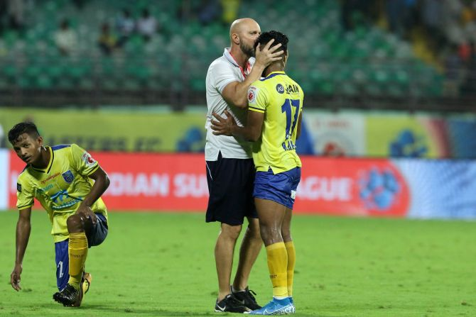 Kerala Blasters' coach Eelco Schattorie consoles his player after the team played out a goalless draw against Odisha FC in their Hero Indian Super League match at the Jawaharlal Nehru Stadium in Kochi on Friday