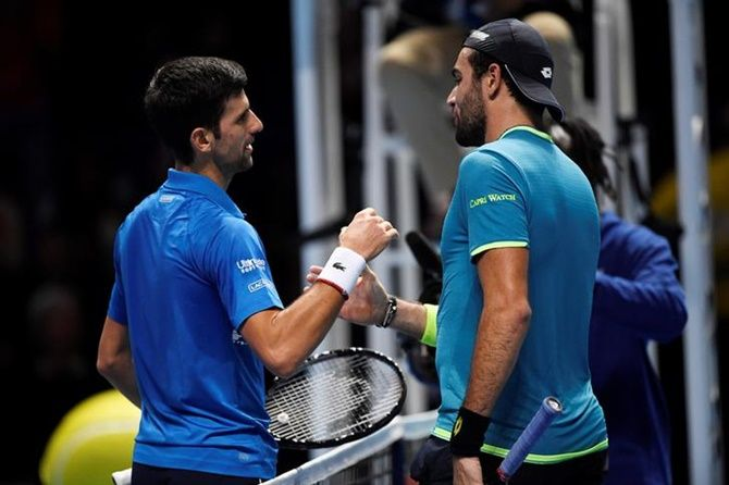 Novak Djokovic is congratulated by Matteo Berrettini after their group stage match.