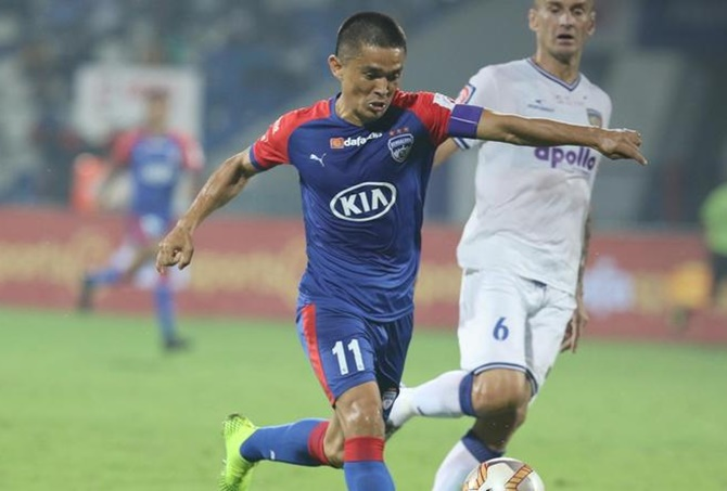 Sunil Chhetri unleashes a rasping drive to score Bengaluru's second goal against Chennaiyin in Sunday's ISL match in Bengaluru