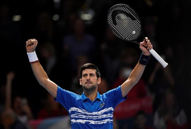 Serbia's Novak Djokovic celebrates winning his ATP Finals group stage match against Italy's Matteo Berrettini