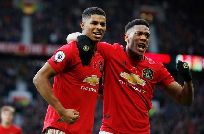 Manchester United's Marcus Rashford celebrates with Anthony Martial scoring third goal during Sunday's Premier League match against Brighton & Hove Albion, at Old Trafford, Manchester