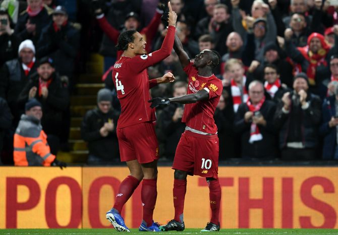 Sadio Mane, right, celebrates after scoring Liverpool's third goal with teammate Virgil van Dijk
