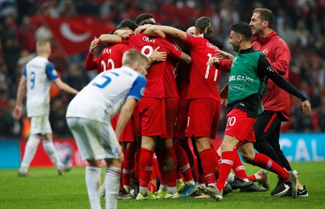 Turkey's players celebrate after holding Iceland goalless