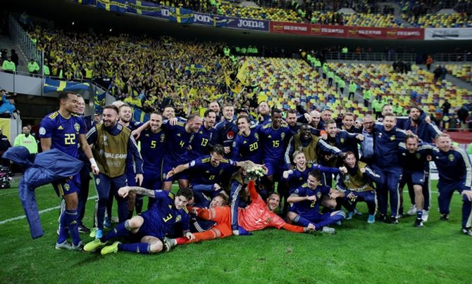 Sweden players celebrate after beating Romania and qualifying.