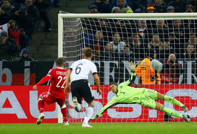 Germany's Manuel Neuer saves a penalty taken by Belarus's Igor Stasevich