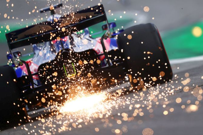 Sparks fly behind Daniil Kvyat's Scuderia Toro Rosso STR14 Honda on track during final practice of the Brazilian F1 Grand Prix on Saturday