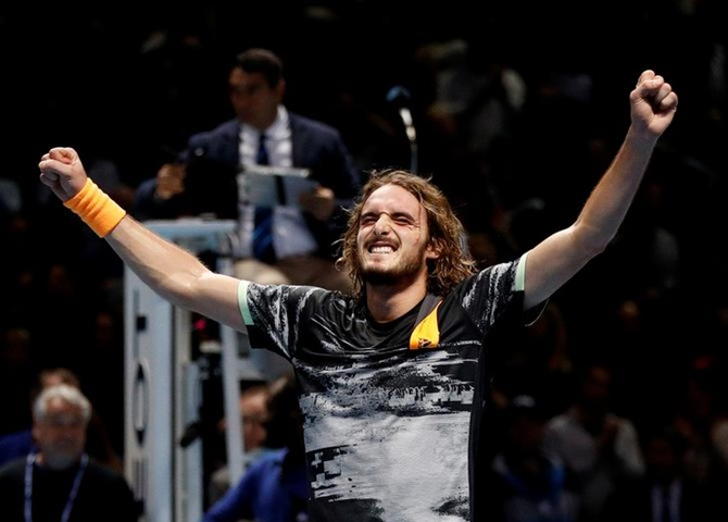 Greece's Stefanos Tsitsipas celebrates defeating Austria's Dominic Thiem and winning winning the ATP Finals, at tyhe O2 Arena, in London, on Sunday.