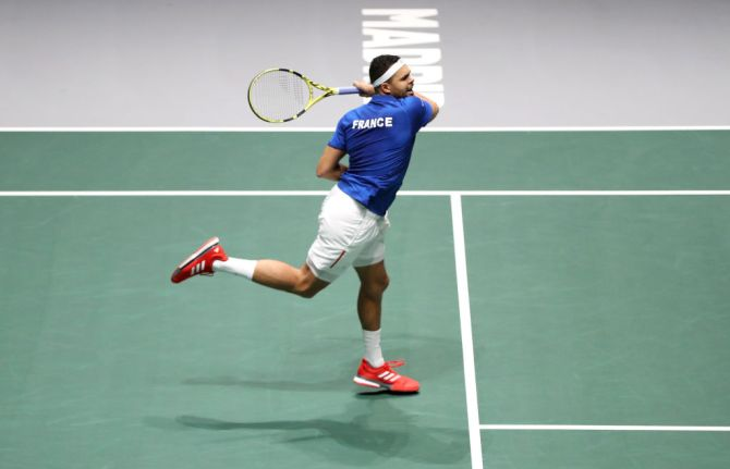 France's Jo-Wilfried Tsonga plays a forehand against Japan's Yasutaka Uchiyama their Davis Cup match at La Caja Magica in Madrid on Tuesday