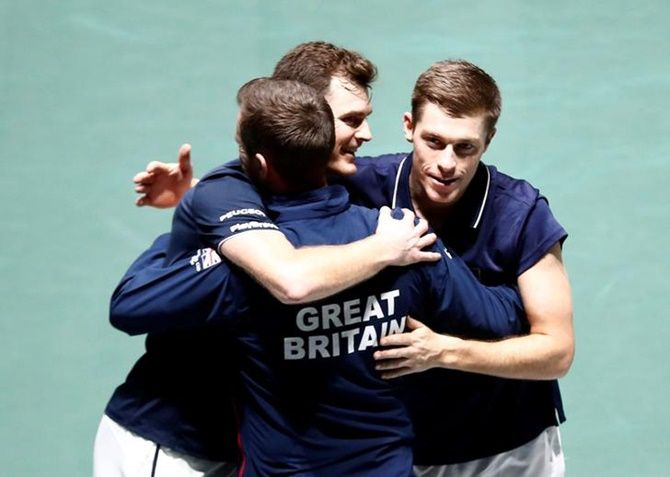 Britain's Jamie Murray and Neal Skupski celebrate with captain Leon Smith after winning their doubles match against Kazakhstan's Alexander Bublik and Mikhail Kukushkin.
